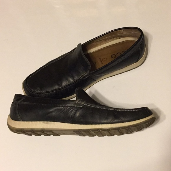 Ecco Navy/ black leather loafer with white sole.
